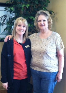 Susan Poplaski (right) stands with ella health technologist Collen Curcio durign a recent visit to ella health.