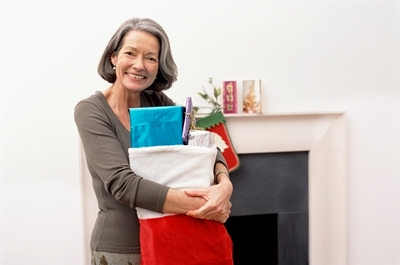 Ella Health woman with gift